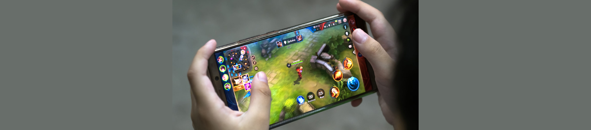 Person Playing a Mobile Game